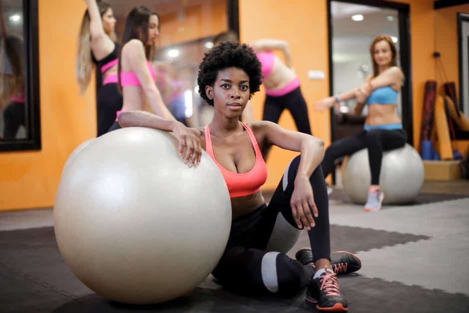 Woman in a gym with her medicine ball